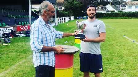 Luke Bess, captain of Bessies Badgers being presented with the winners trophy after his team' succes