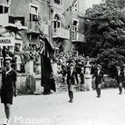 A march past of the Canadian contingent outside Torre Abbey. The square vase over the door will hold