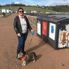 Cllr Karen Kennedy with the recycling bins at Broadsands Beach