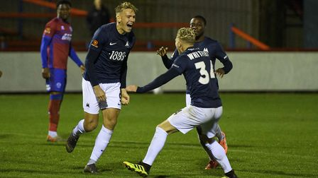 Goal! Danny Wright celebrates with Aaron Nemane and Ben Whitfield. Photo: James Fearn/PPAUK