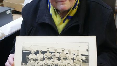 Councillor Ian Doggett choosing a photograph of Torquay United from the museum's archive