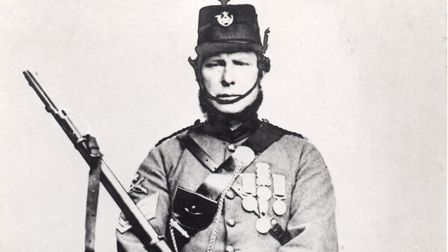 William Rogers in the uniform of the Bideford Rifle Volunteers wearing his Crimean medals.