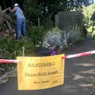 Friends of Stoodley Knowle at work near the community café, caring for planted beds. Photo: Groundwo