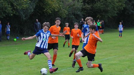 Ottery St Mary striker Finn Upsher in the thick of the action dtring the Otters 4-2 defeat to Alphin