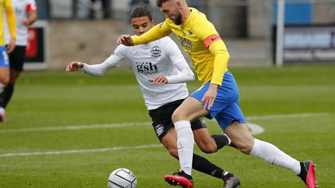 Kyle Cameron goes past TJ Bramble of Dover Athletic. Photo: Dave Crawford/PPAUK