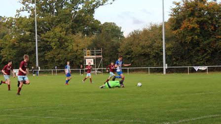 Jake Johnson scores the first of his hat-trick in the victory over North Tawton at Washbrook Meadows