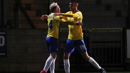 Louis Britton celebrates his goal with Ben Whitfield during the match between Torquay United and Che