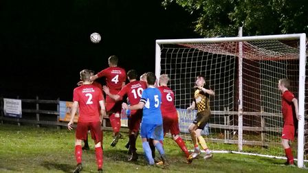 Action from the Honiton Town 6-3 defeat at Bovey Tracey. Picture: ANDREW SYMONDS