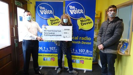 The Voice FM station manager Jim Trevelyan hands a cheque over to North Devon councillors Caroline