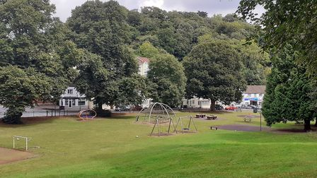 A view of Victoria Park in Chelston, a variety of play equipment dotted around the green space. Phot