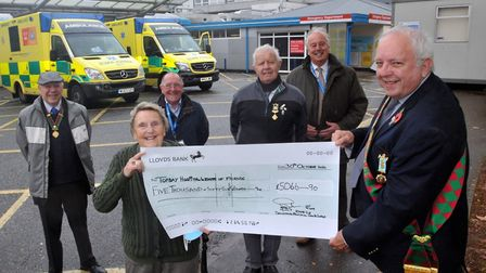 The Buffaloes hand over the cheque to the League - Pictured from left to right are: Brother Geoff D