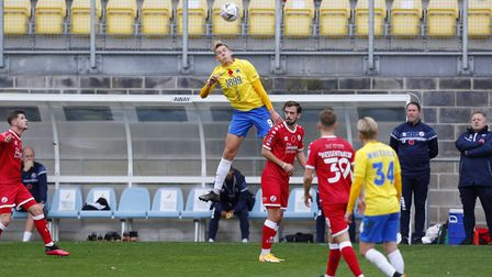 Danny Wright leaps the highest during the FA Cup First Round match between Torquay United and Crawle