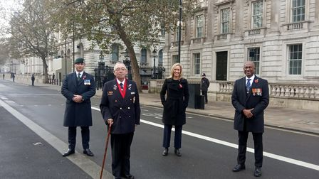 Councillor Michael Clarke (second from left), pictured with Tom Fox, who served with the Royal Green