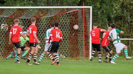 Action from the Honiton Town 2-1 defeat to Elmore. Picture; ANDREW SYMONDS