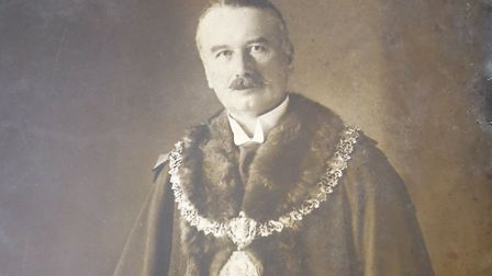 Portrait of Harry Williams, Mayor of Torquay, wearing his regalia that can be seen on display at the