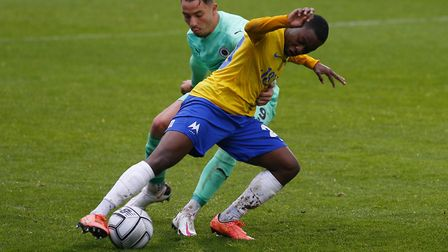 Aaron Nemane battles for the ball with Kane Smith of Boreham Wood during the match between Torquay United and Boreham Wood at...