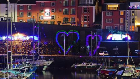 Special heart-shaped lights were shone over the Brixham quayside for the Joanna C crew. Photo: Chris