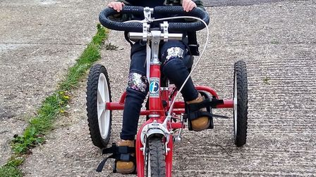 Jaydi trying out an adapted trike. Picture: Lisa Hawker.