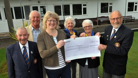 Babbacombe Bowling Club's Dave Thomas hands over the cheque to the League of Friends