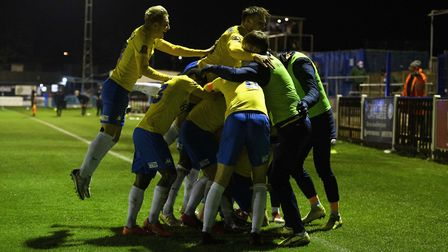 GOAL! Billy Waters of Torquay United celebrates with his teammates having dramatically scored to gai