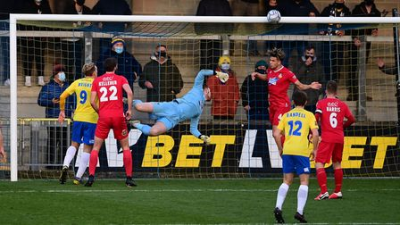 Theo Vassell of Wrexham heads the ball off the line after Robert Lainton, Goalkeeper of Wrexham is
