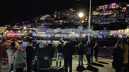 Brixham harbour is lit up in memory of the Joanna C crew