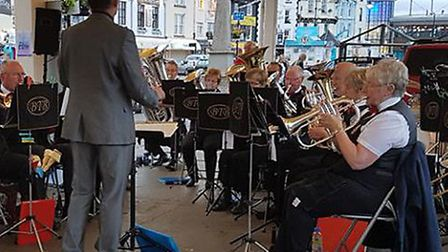 Brixham Town Band performing on the Quayside before the pandemic