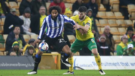 Izzy Brown of Sheffield Wednesday and Grant Hanley of Norwich in action during the Sky Bet Champions