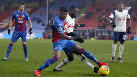 Crystal Palace's Patrick van Aanholt (left) and Tottenham Hotspur's Tanguy Ndombele battle for the b