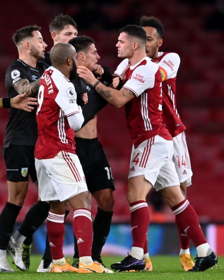 Arsenal's Granit Xhaka (right) grabs Burnley's Ashley Westwood (18) round the throat which results i