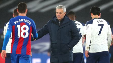 Tottenham Hotspur manager Jose Mourinho shakes hands with Crystal Palace's James McArthur (left) aft