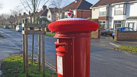A mystery knitter has added some festive spirit to the postbox on Trafford Road in Norwich. Picture: