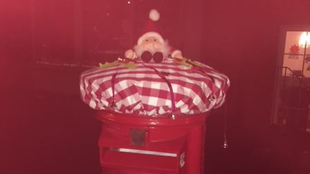 Christmas decorations spotted on a post box on Unthank Road in Norwich.