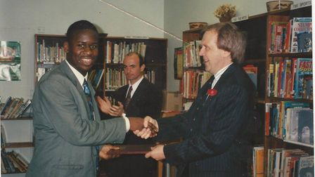 St George's headteacher Philip Lawrence (right) givingEdward Adoohis national record of achievement in 1995