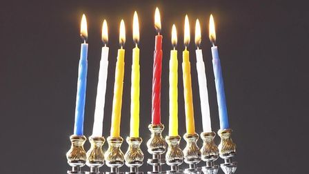 """The silver candlestick used in the Jewish festival of Hunnukah (the""""Festival of Lights"""")."""