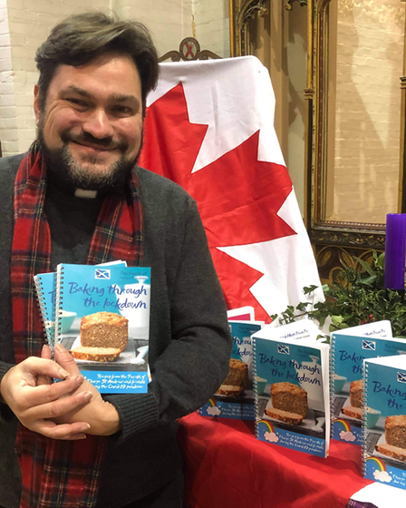 Revd James Stewart pictured with the cookbook which includes some recipes from Canada.