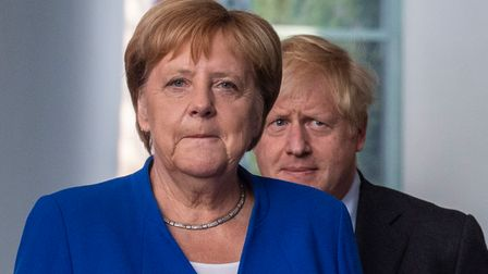 German Chancellor Angela Merkel (L) and British Prime Minister Boris Johnson arrive for a press conference in August 2019