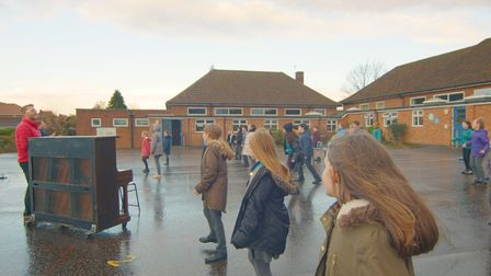 Sprowston Junior Rehearsing the song 'Little Things' outdoors.