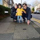 Dara Shafiri (2) pictured centre with parents Behnaz and Reza Sharifi, next to the manhole that he f