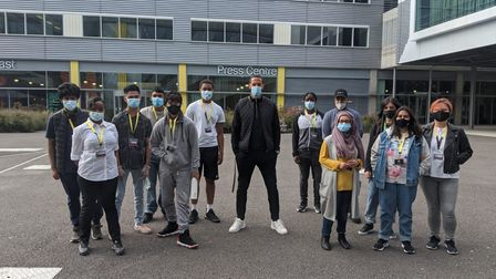 NewVIc media students standing with former West Ham and Manchester United footballer and BT Sport pundit Rio Ferdinand...