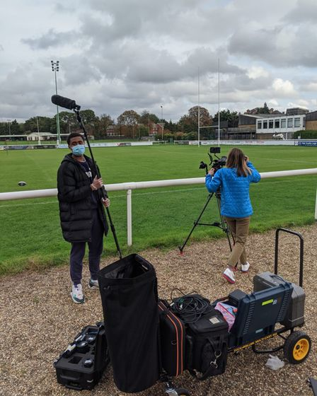 NewVIc students with filming equipment beside a rugby field