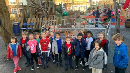 Year 1 pupils at Thornhill Primary School meet a happy pair of reindeer.