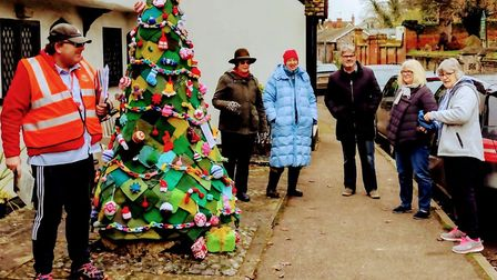 Barley yarn-bombers with their creation. Picture: The Barley Knitting Group