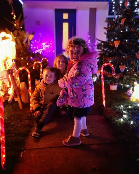 Martyn, Jemma, Grace and Oliver Schofield, along with neice Ellie, set up their Christmas decorations in Oakhill...