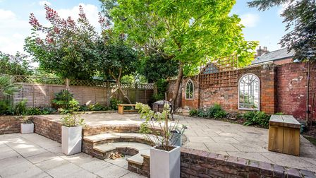 There is a courtyard garden to the rear of the property. Picture: Hamptons