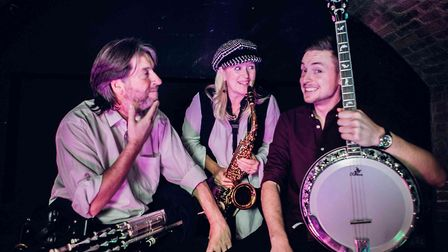 The Devines are multi-instrumentalist John Devine, saxophonist Caz Devine, and their son Joe on guitar and banjo. They...
