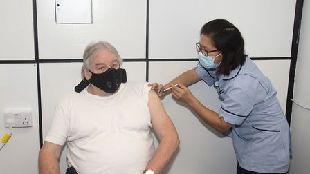 John Deakin, 81, pictured with nurse Ruth Osis, was the first person to receive his COVID-19 vaccine at Lister Hospital in...