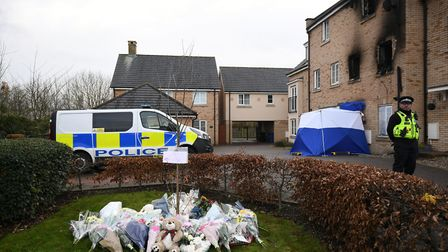 Floral tributes at the scene of a house fire on Buttercup Avenue, Eynesbury, Cambridgeshire, in which a three-year-old boy an...