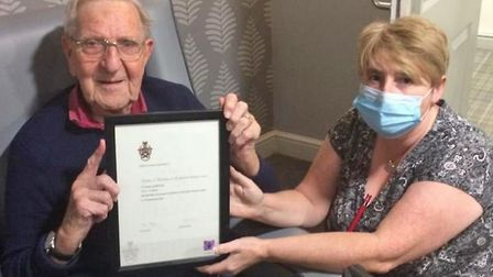 Staff and residents at Lyncroft Care Home in Wisbech celebrated with resident Leslie Maleham who has been awarded an...