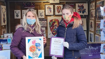Amy Pettingill with competition winner Annabelle collecting her certificate